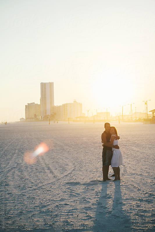 Young couple enjoying on the beach by Borislav Zhuykov for Stocksy United