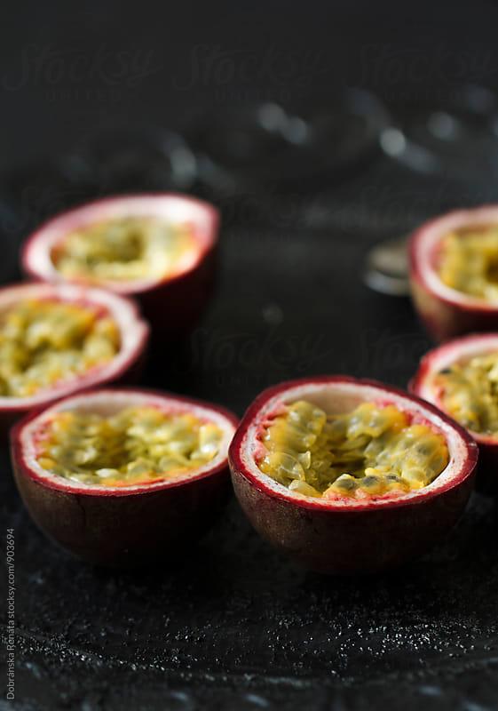 Halved passion fruits by Dobránska Renáta for Stocksy United