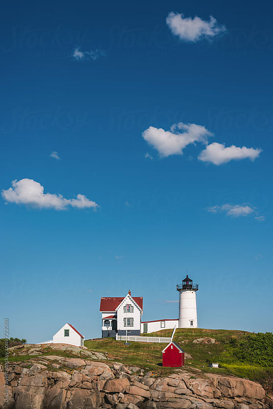 Lighthouse Beneath Blue Skies by Leslie Taylor for Stocksy United
