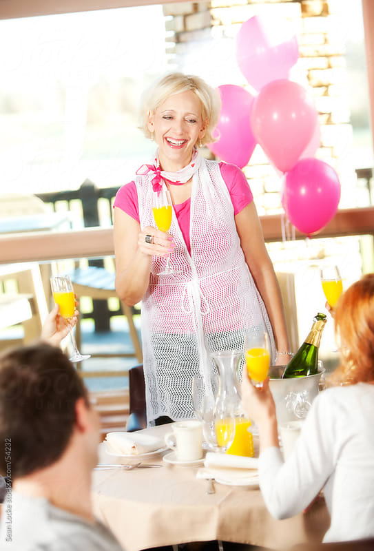 Pink: Mature Woman Toasts with Mimosa by Sean Locke for Stocksy United