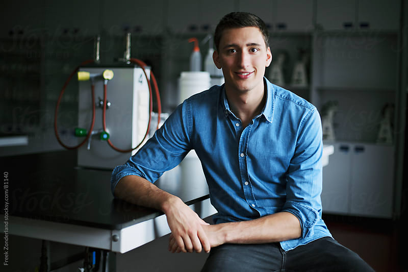 Young casual man in lab  by Freek Zonderland for Stocksy United