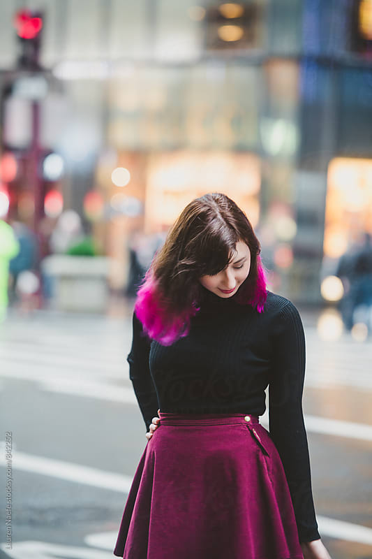 Young woman with pink hair in the city by Lauren Naefe for Stocksy United