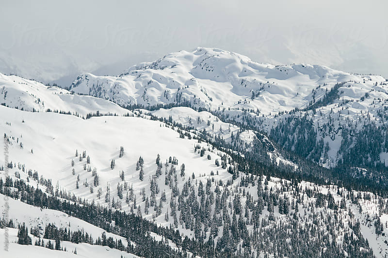 Mountains with snow landscape. Backcountry aerial view by Alejandro Moreno de Carlos for Stocksy United