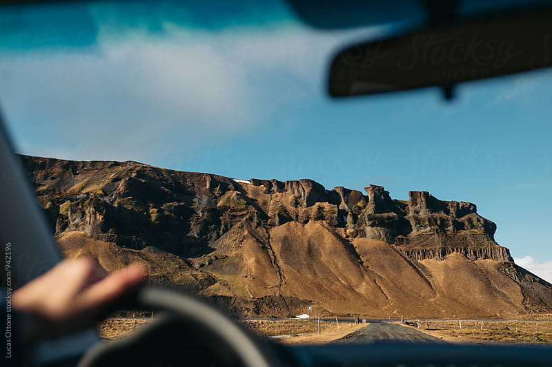 From the car: road and mountain ahead by Lucas Ottone for Stocksy United