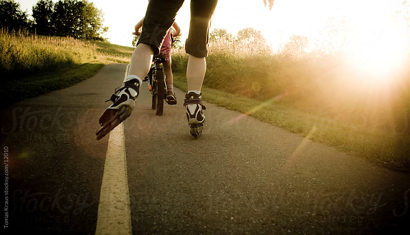 summer activity rollerblading in park by Tomas Kraus for Stocksy United