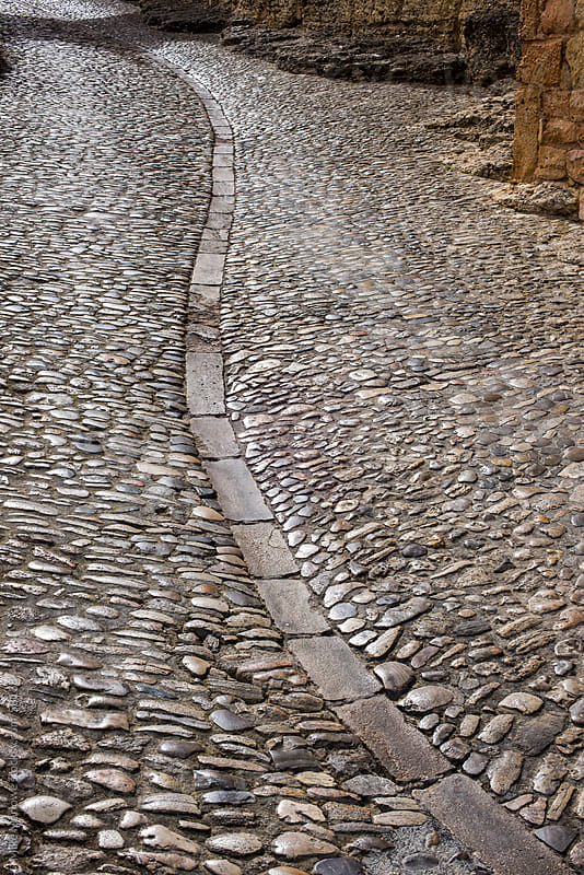A cobbled street with S shaped curve. by Mike Marlowe for Stocksy United