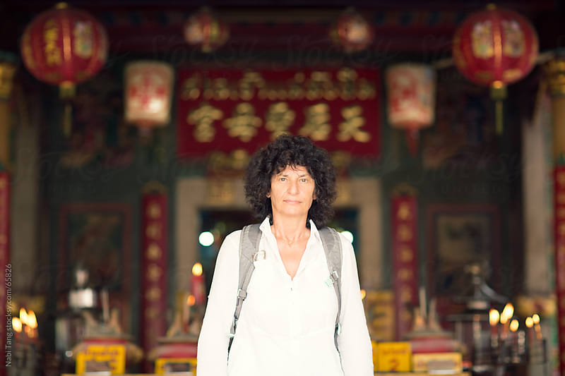 Portrait of a senior tourist in Chinese temple by Nabi Tang for Stocksy United