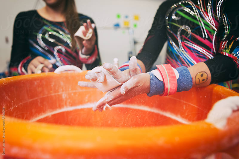 Gymnastics: Girls Getting Chalk On Hands Before Practicing Bars by Sean Locke for Stocksy United