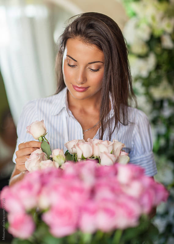 Florist working in her flower shop. by Mosuno for Stocksy United