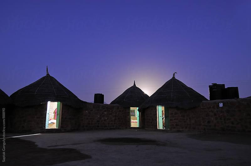 Moonlit desert huts,Jaisalmer,Rajasthan by Saptak Ganguly for Stocksy United
