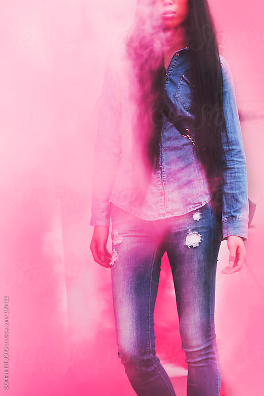 Asian woman on rooftop and pink smoke bomb. by BONNINSTUDIO for Stocksy United