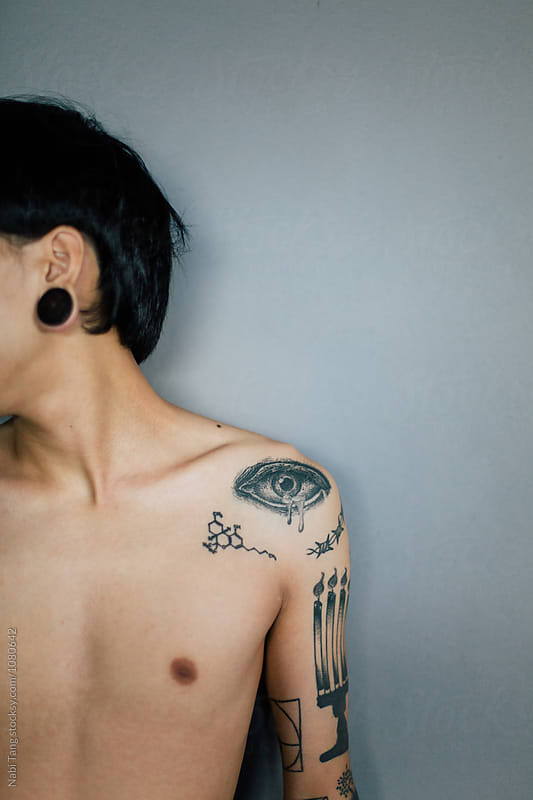 Young man with eye tattoo on the shoulder by Nabi Tang for Stocksy United