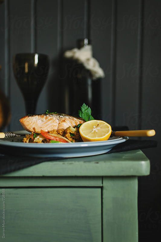 Roast salmon fillet with fennel couscous. by Darren Muir for Stocksy United