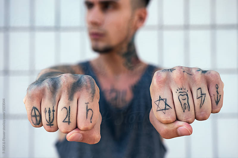 Close-up of tattooed man's knuckles by T-REX & Flower for Stocksy United
