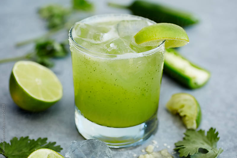 Gourmet cocktail margarita with lime, jalapeno, salt and cilantro  by Trinette Reed for Stocksy United