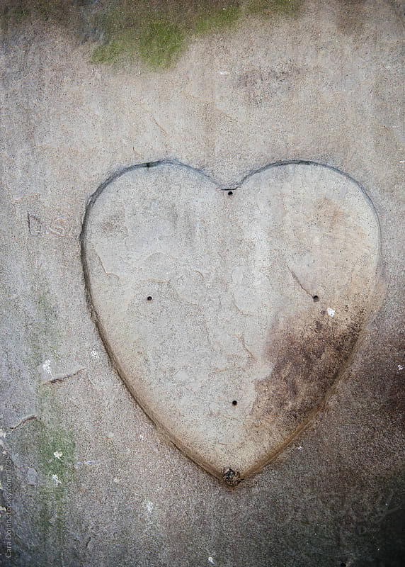 The spot in the wall where a heart-shaped plaque once was by Cara Dolan for Stocksy United