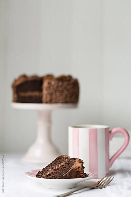 Stripey mug and chocolate cake by Ruth Black for Stocksy United