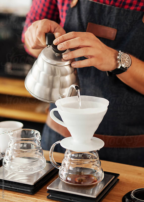 Barista pouring and brewing a pot of filter drip coffee by W2 Photography for Stocksy United