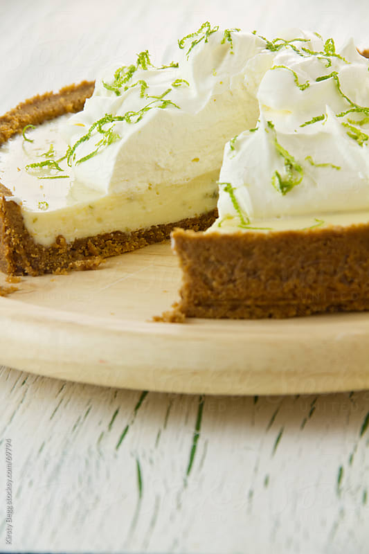 Key Lime Pie with cream, cross section by Kirsty Begg for Stocksy United