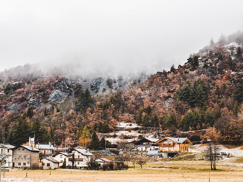 a mountain village in winter by Milena Milani for Stocksy United
