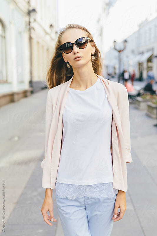 Portrait of young blonde woman wearing sunglasses by Andrey Pavlov for Stocksy United