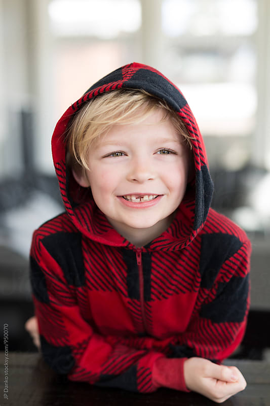 Portrait of Mischievous Blonde Little Boy With Messy Hair Grinning With Missing Tooth by JP Danko for Stocksy United