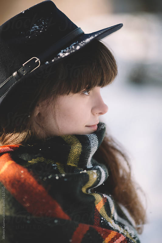 winter close-up of the young woman with hat by Alexey Kuzma for Stocksy United