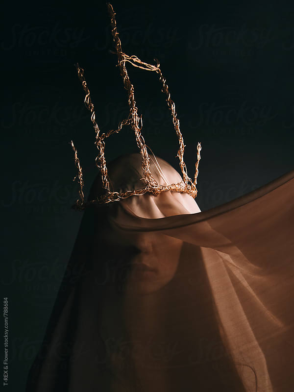 Woman under veil in gold crown made of wire by Danil Nevsky for Stocksy United
