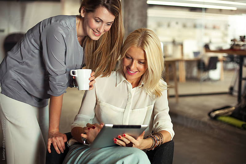 Businesswomen With a Digital Tablet by Lumina for Stocksy United