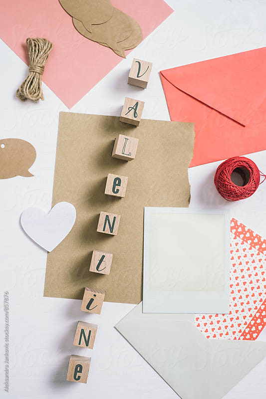 Valentine Stamps and Cards on the Table by Aleksandra Jankovic for Stocksy United
