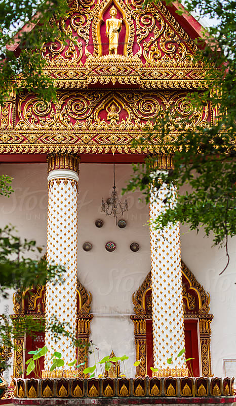 Entrance to buddhist temple with golden ornaments. by Marko Milanovic for Stocksy United