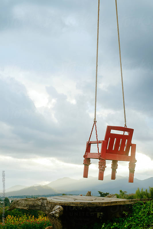 Swing chair by Artem Zhushman for Stocksy United