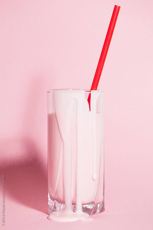 A glass of yogurt with sipping straw by Danil Nevsky for Stocksy United