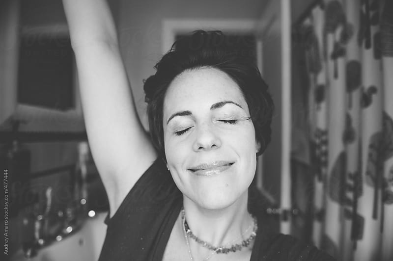 Black and white image of happy relaxed woman by Audrey Amaro for Stocksy United