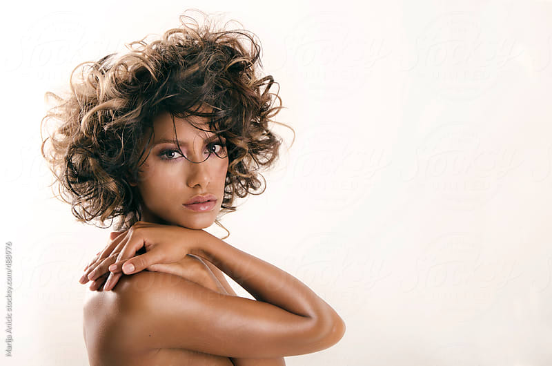 Beautiful brunette woman with curly hair by Marija Anicic for Stocksy United