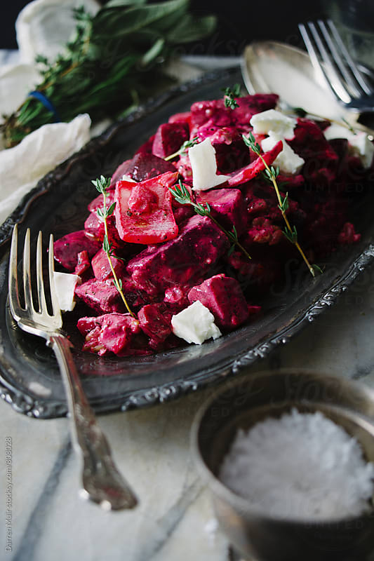 Roasted beets and feta salad. by Darren Muir for Stocksy United