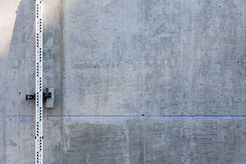 Grade rod on a concrete wall by Luis Cerdeira for Stocksy United