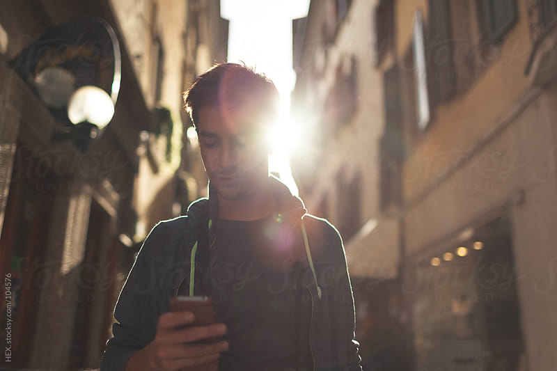 Man using at the Mobile Phone by HEX. for Stocksy United