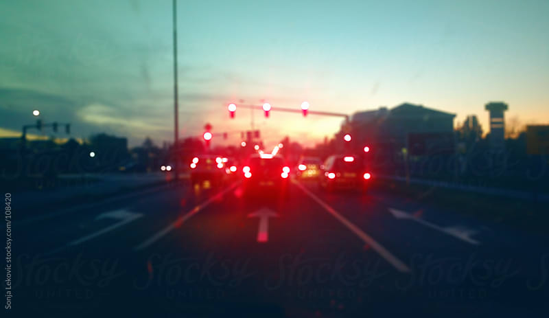 blurred red light traffic by Sonja Lekovic for Stocksy United