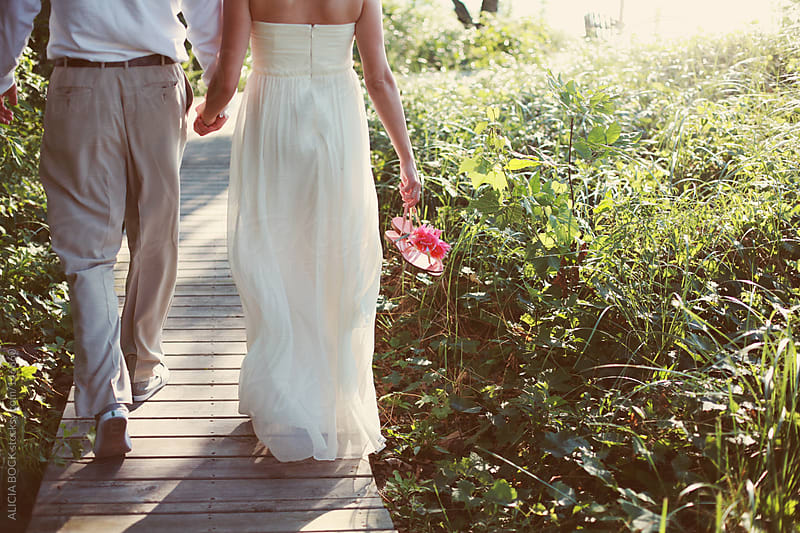 Bride and Groom Walking by ALICIA BOCK for Stocksy United