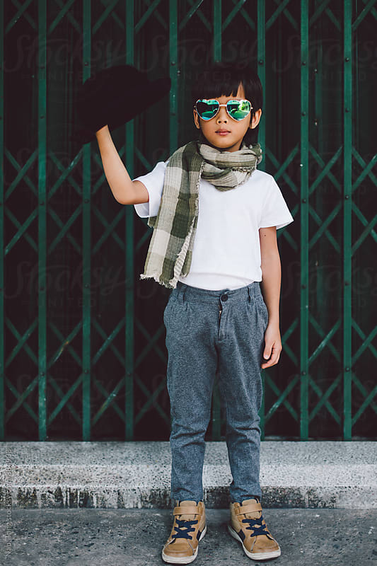 Cool kid on the street in Bangkok by Nabi Tang for Stocksy United