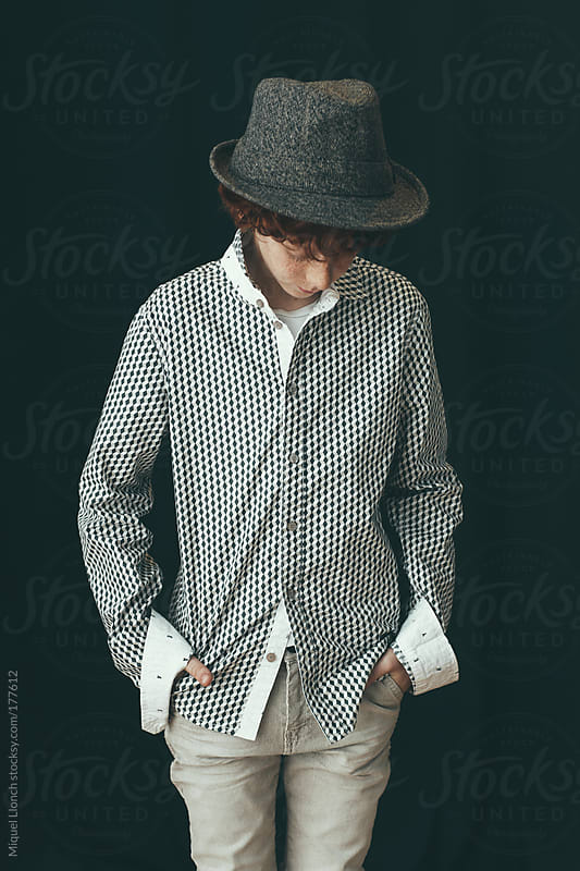 Portrait of a young boy with hat by Miquel Llonch for Stocksy United