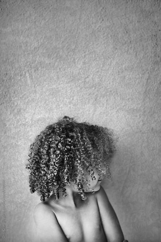 Side View of African American Child With No Shirt by Dina Giangregorio for Stocksy United