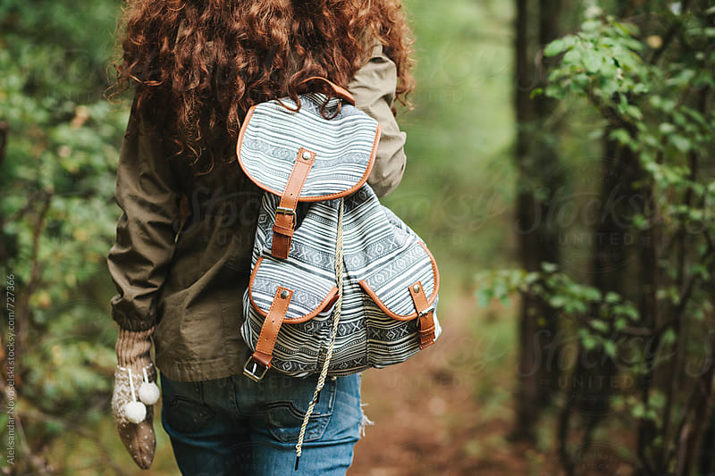 Young woman hiking in the mountain, shot from behind by Aleksandar Novoselski for Stocksy United