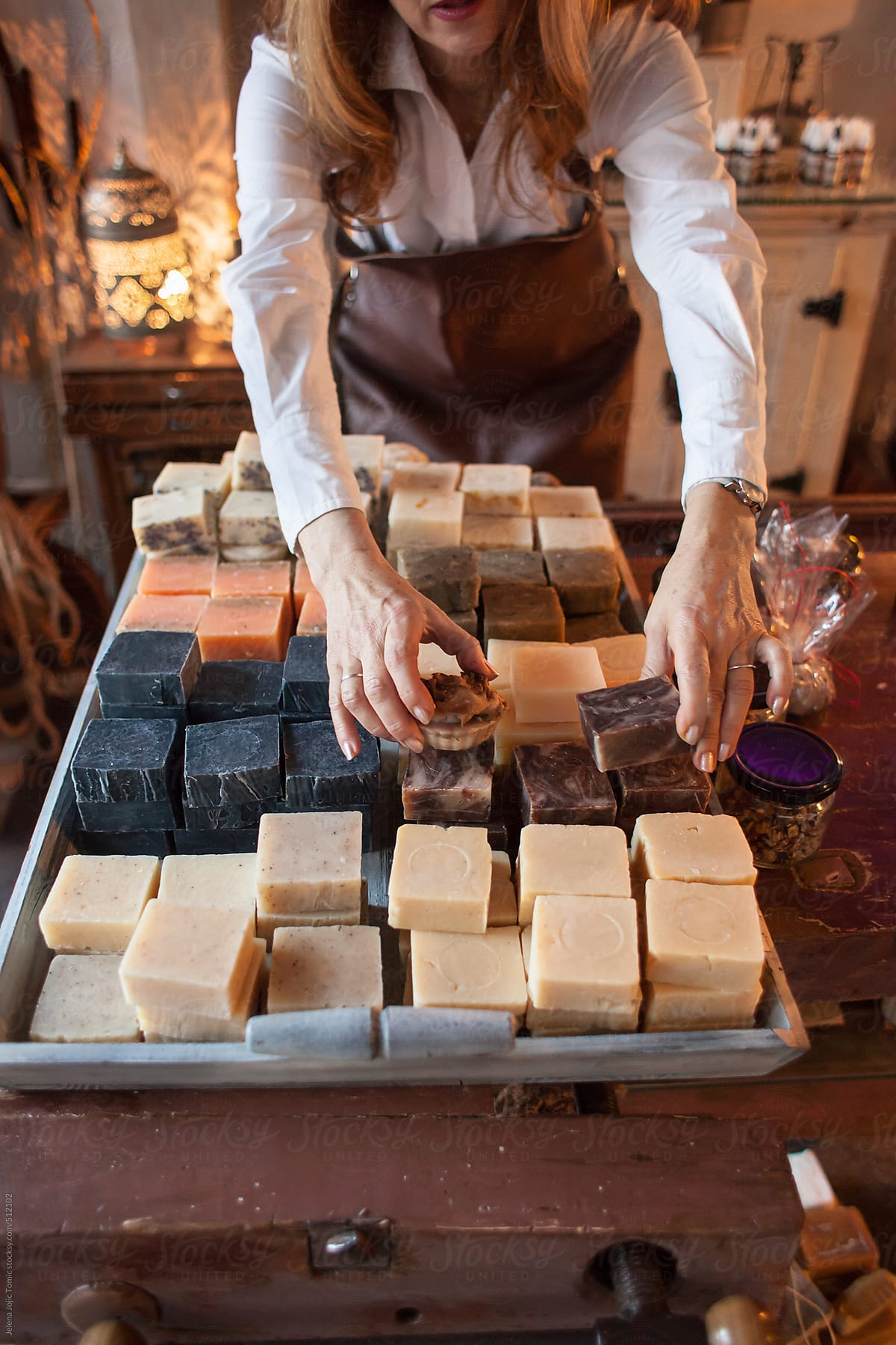 Senior businesswoman in her handmade soap shop by Jelena