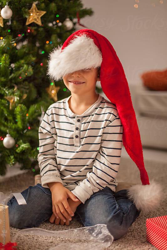 Cute Boy Wearing Santa's Hat by Mosuno for Stocksy United