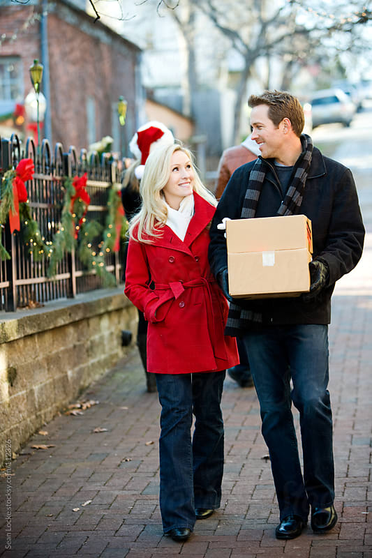 Christmas: Taking Boxes to Ship at Christmas by Sean Locke for Stocksy United