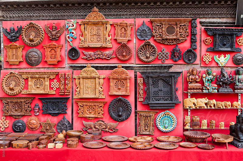 Wooden craft for sale at a curio shop in Bhaktapur, Nepal. by Shikhar Bhattarai for Stocksy United