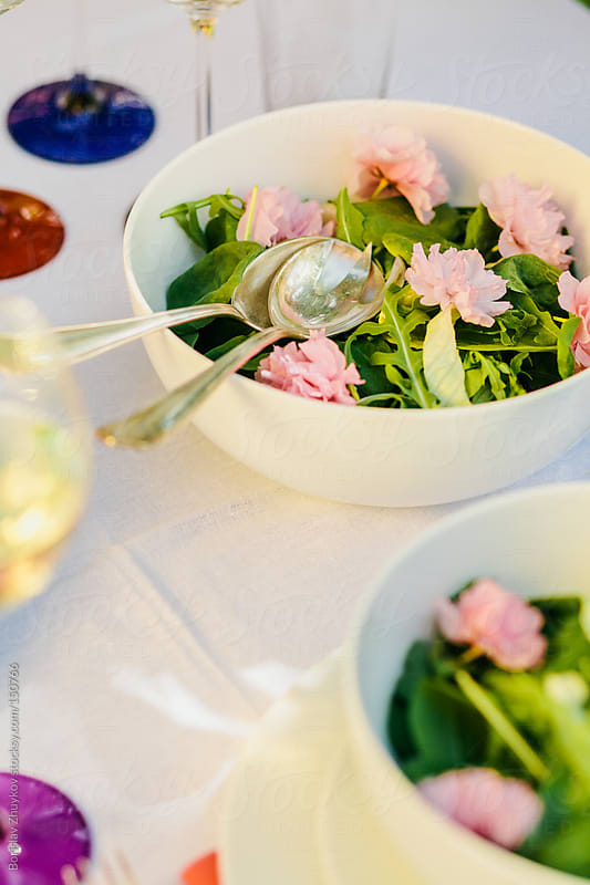Beautiful spring decorated table with flower salad by Borislav Zhuykov for Stocksy United
