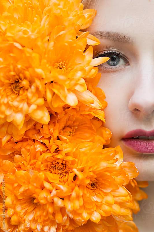 Half girl's face; half flowers by Jovana Rikalo for Stocksy United